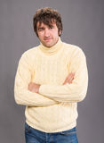 Posing handsome man in sweater Stock Image