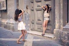 Posing like models. Two girls posing like models royalty free stock image