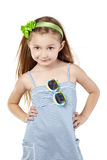 Posing little girl in striped blue sundress Stock Images