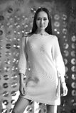 Posing model, white dress, long hair, computer disks Royalty Free Stock Image