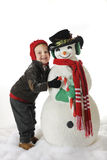 Posing with My Snowman Royalty Free Stock Photography