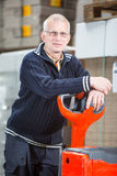 Posing with a pallet truck Stock Photography