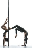 Posing of pole dance couple in studio Royalty Free Stock Photography