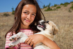 Posing with puppy Royalty Free Stock Images