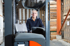Posing reach truck driver Stock Photos