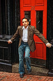 Posing at red door Stock Photography