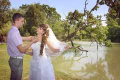Posing on riverside. Loving couple embracing on a riverside Royalty Free Stock Images