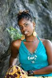 Posing on the rock2. African American woman poses in front of a large rock royalty free stock photo