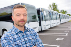 Posing with row buses Royalty Free Stock Photo