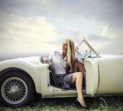 Posing and sitting in a vintage car Royalty Free Stock Image