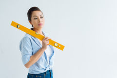 Posing with spirit level Royalty Free Stock Images