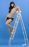 Posing on a stepladder. Stock Photography