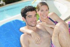 Posing beside swimming pool Stock Photography