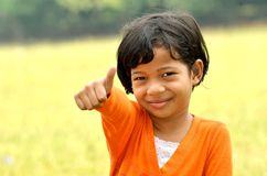 Posing a tumb. Young asian girl posing a thumbs Royalty Free Stock Photo