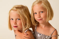 Posing twins Royalty Free Stock Images