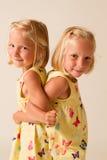 Posing twins Stock Image