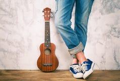 Posing with ukulele. Stock Photos