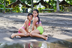 Posing Wet. Two young girls posing after going out of the water royalty free stock images