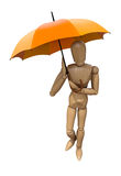 Posing wooden manikin with umbrella. Royalty Free Stock Image