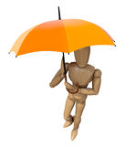 Posing wooden manikin with umbrella. Royalty Free Stock Photography