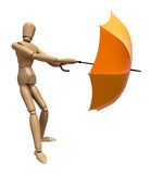 Posing wooden manikin with umbrella. Stock Photos