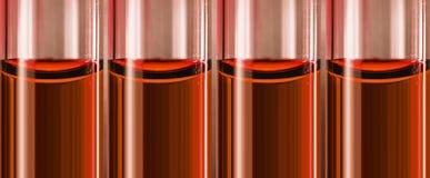 Posion dans des tubes de verre dans de petits tubes de verre Photographie stock