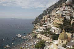 Positano on the Amalfi Coast, Italy. Mediterranean sun shines on the old buildings of Positano in Italy. The photo evokes a sense of past and travel Stock Image