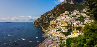 Positano on Amalfi Coast near Naples in Italy. Beach streets and colorful houses on the hill in Positano on Sorrento Peninsula in South Italy royalty free stock photo