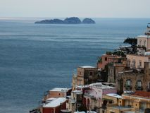 Positano and islet of Li Galli. Positano, Salerno, Campania, Italy - March 13, 2016: Panoramic view of the town and the islet de Li Galli royalty free stock photos
