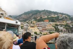 POSITANO, ITALY - JULY 4, 2018: people traveling on the ferry boat take picture of Positano town, Amalfi Coast, Italy.  stock image