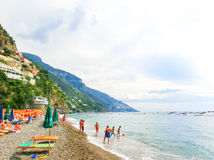 Positano, Italy - September 11, 2015: The people resting at Positano, Italy along the stunning Amalfi Coast. Royalty Free Stock Image