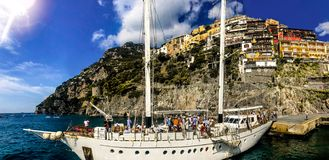 Positano, Italy, September 6, 2018: Scenic view from a sailing yatch of the seashore of Positano stock photos