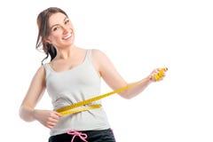 Positief slank meisje met centimeter Stock Afbeeldingen