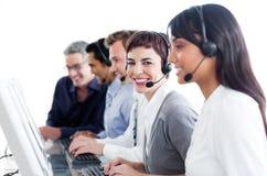 Positieve bedrijfsmensen die hoofdtelefoon met behulp van royalty-vrije stock foto