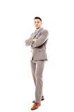 Positieve zakenman met gevouwen wapens Royalty-vrije Stock Foto's