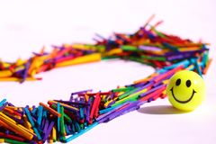 Rainbow made of  multicolors woodsticks. Positine enrgy of unique rainbow made of wooden sticks with great slogan of love stock images