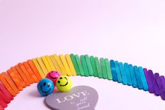 Rainbow made of  multicolors woodsticks. Positine enrgy of unique rainbow made of wooden sticks with great slogan of love royalty free stock images