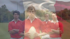 Position d'équipe de rugby et regard à la caméra avec un drapeau français sur le fond