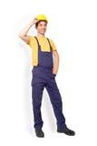 Position de travailleur de mécanicien d'isolement sur le fond Photo stock