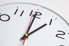 Position för ett klockan Arkivbilder