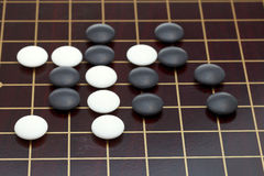 Position of stones during go game. Playing on wooden goban Royalty Free Stock Photography