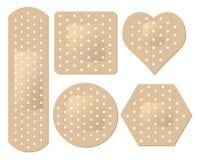 Positionnement adhésif de bandage Photographie stock