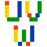 Positionnement d'alphabet fait de blocs de brique de construction de jouet Photographie stock libre de droits