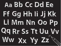 Positionnement de lettre d'alphabet de craie de crayon ou de charbon de bois Images libres de droits
