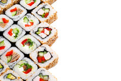 Positionnement de roulis de sushi grand avec différents composants Image libre de droits