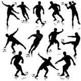 Positionnement de silhouette d'homme du football Image stock