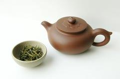 Positionnement de thé et théière image stock