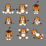 Positionnement mignon de dessin animé de tigre Image libre de droits