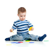 Positionnement se réunissant de construction de petit enfant Photos stock