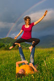 Positions Acroyoga girl of male in nature Royalty Free Stock Images